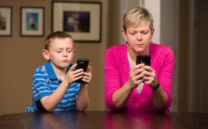 Mother and son obsessed with texting